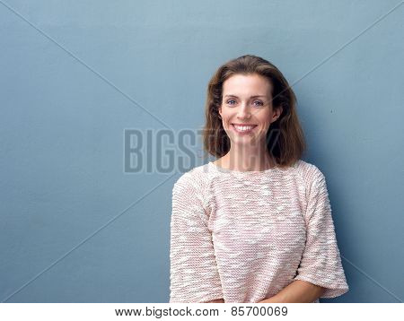 Beautiful Mid Adult Woman Smiling On Gray Background