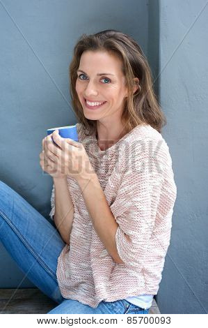 Beautiful Mid Adult Woman Smiling With Cup Of Coffee
