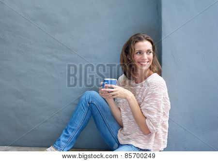 Attractive Mid Adult Woman Relaxing With A Cup Of Coffee
