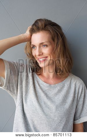 Attractive Mid Adult Woman Smiling With Hand In Hair