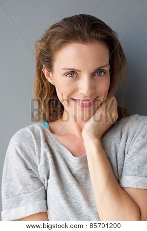 Cute Mid Adult Woman Relaxed And Smiling