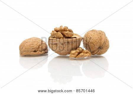 Walnuts Close Up On White Background With Reflection