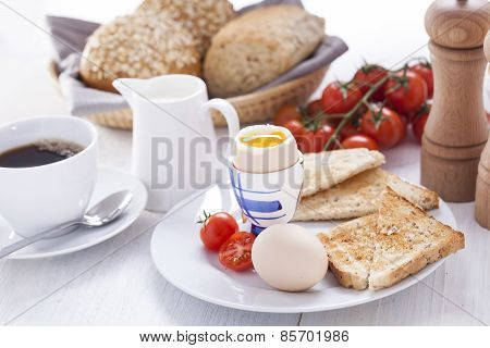 Soft-boiled Egg In The Morning With Toast. In The Background Of The Jam, Coffee, Tomatoes And Snap.