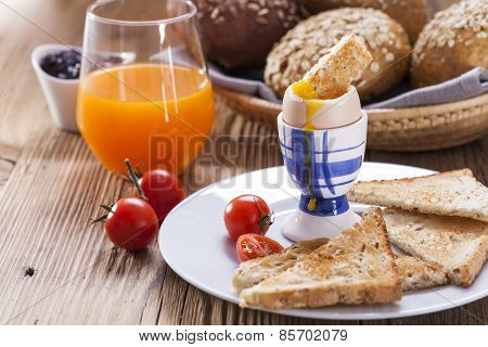 Soft-boiled Egg In The Morning With Pepper, Tomatoes And Croutons. In The Background Of The Jam, Jui