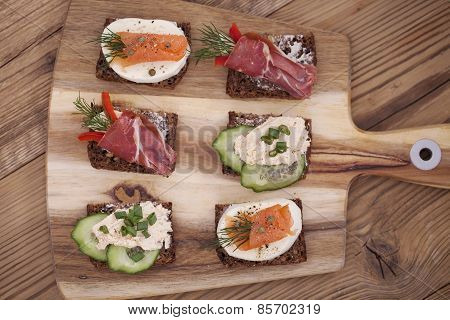 Delicious Little Sandwiches With Tuna, Cheese, Prosciutto And Vegetables.