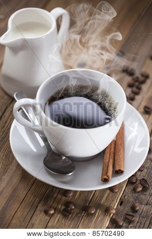 Delicious Coffee With Sweets On A Wooden Table