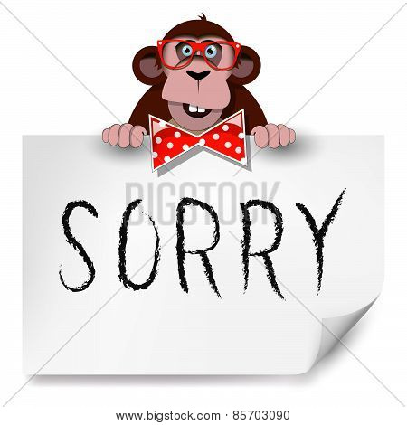 Cartoon Monkey With Glasses Holding A Sheet Of Paper On Which Is Written Sorry.