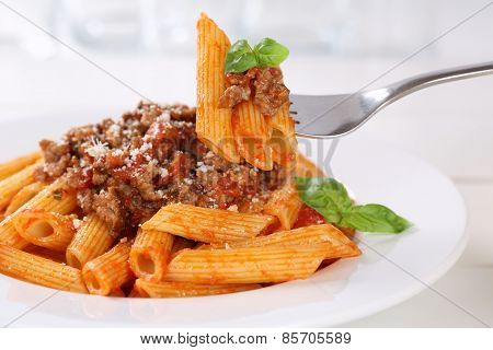 Eating Penne Rigate Bolognese Or Bolognaise Sauce Noodles Pasta Meal