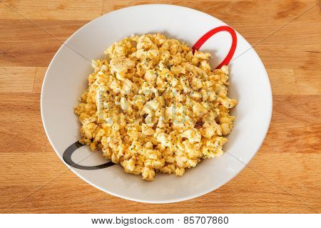 Scrambled eggs with cheese and basil