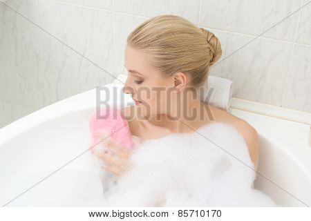 Woman Relaxing In Bath And Washing Herself