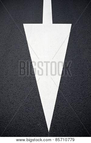 Single arrow directional sign on the floor.