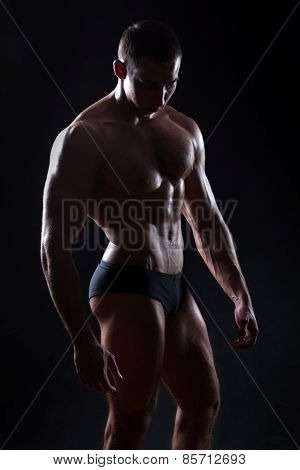 Figure Bodybuilder On A Black Background.