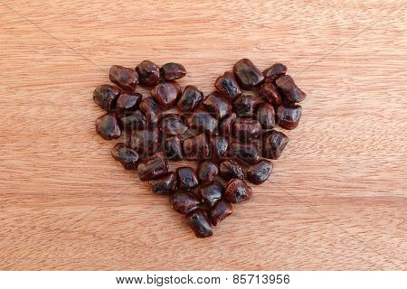 Pile Of Tamarind Seed In Shape Heart