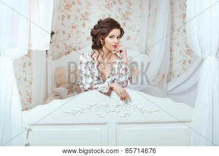 Girl Peeking Through The Headboard.