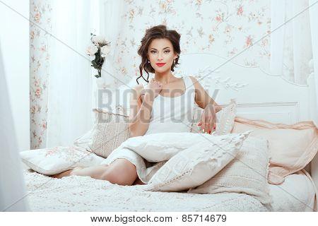 Girl Among The Pillows.