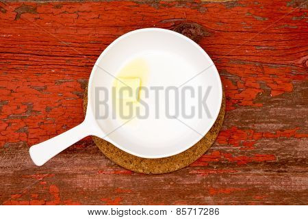 Melting Butter On White Serving Plate With Handle