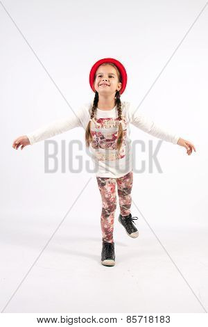 Little Girl In Dance Creations With Red Hat