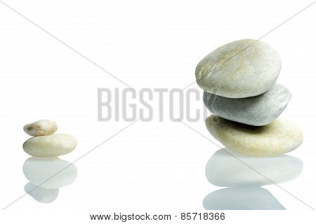 Stones Stacked Isolated With Reflection
