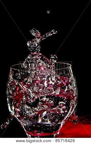 Ice Splashing Into A Glass