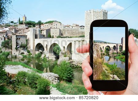 Tourist Shoots Photo Of Bridge In Besalu Town