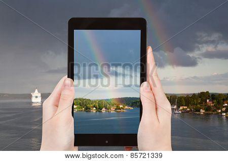 Tourist Photographs Of Rainbow Over Baltic Sea