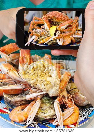 Tourist Photographs Of Seafood Plate With Crab, Prawns, Shrimps