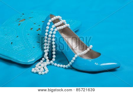 Beautiful blue shoes and handbag, pearls