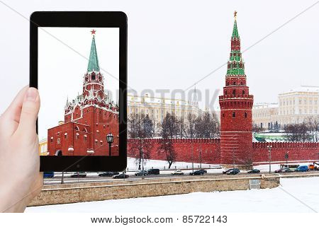 Tourist Photographs Kremlin In Winter Snowing Day