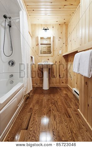 Washroom interior with pine wood wall planking