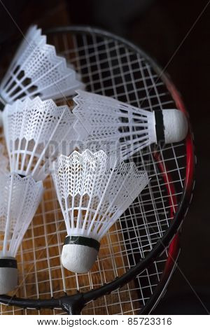 Plastic shuttlecocks on badminton rackets