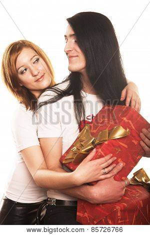 couple with a gift over a white background