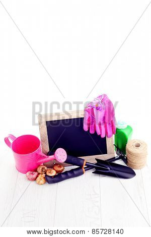 gardening tools and frame on a wooden table - flowers and plants