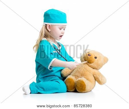 Adorable child dressed as doctor playing with toy