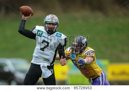 VIENNA, AUSTRIA - MARCH 23, 2014: QB John Van Den Raadt (#7 Raiders) passes the ball in an AFL football game.