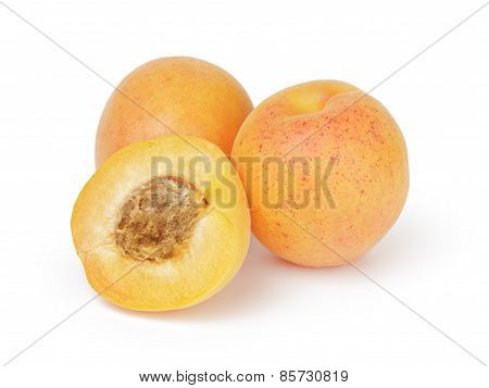 three ripe apricot fruits one half sliced isolated