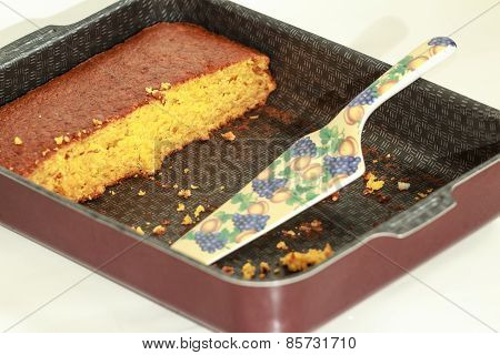 Piece of pumpkin cake and pie server