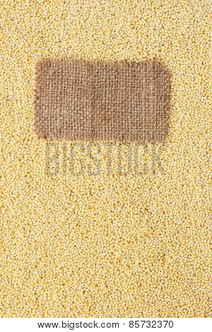 Tag Made Of Burlap Lies Against The Backdrop Of Millet