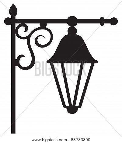 Silhouette lamp of wrought metal