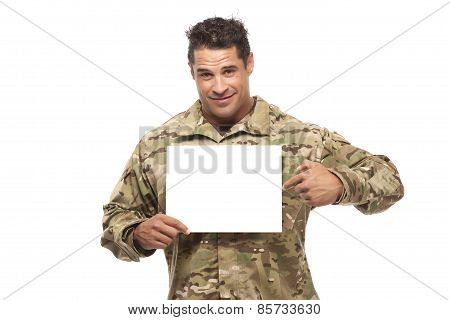 Smiling Soldier Pointing At Placard