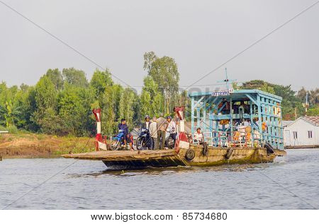 CHAU DOC, VIETNAM, JANUARY 3, 2013:Local people travel on a ferry on Hau River (Bassac River) in Chau Doc in Mekong Delta