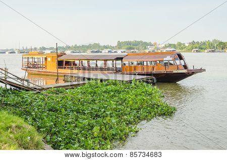 CHAU PHONG, VIETNAM, JANUARY 3, 2013: Tourist boat wait for tourists visiting village Chau Phong in Mekong Delta