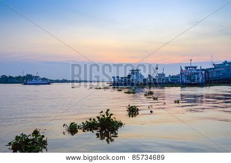 CHAU DOC, VIETNAM, JANUARY 3, 2013: Port on Hau River (Bassac River) in Chau Doc in Mekong Delta, at dawn