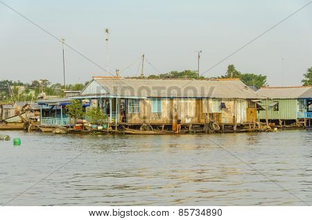 CHAU DOC, VIETNAM, JANUARY 3, 2013: Floating village on Hau River (Bassac River) in Chau Doc in Mekong Delta