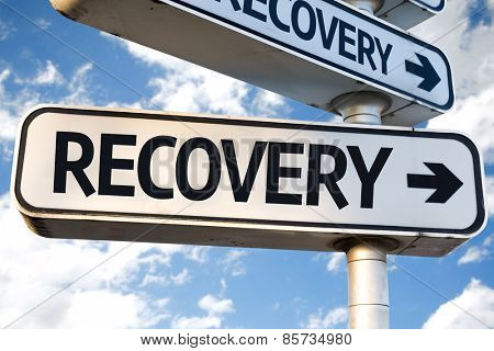 Recovery direction sign on sky background