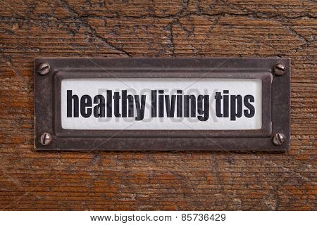 healthy living tips  - file cabinet label, bronze holder against grunge and scratched wood
