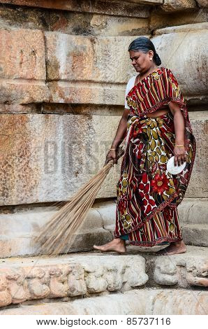 Indian Woman In National Dress Carries A Broom