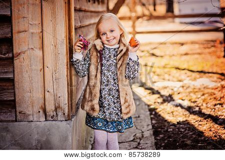 cute happy child girl playing with fabric easter chicken at country house