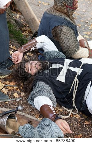 ZAGREB, CROATIA - OCTOBER 07, 2012: Young knight resting after the battle at