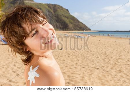 Boy With Sun Lotion On Shoulder