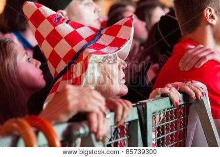 ZAGREB, CROATIA - JUNE 12, 2014: Elderly woman wearing hat in Croatian colors at Ban Josip Jelacic square support  national team during the world cup match between Croatia and Brazil.